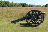 Old metal cannon used in historical war, on display in the fields where men fought and died for our freedom. — Stock Photo