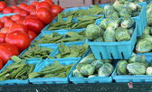 Fresh vegetables on display at the local market — Stock Photo