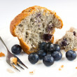 Blueberry muffin with fresh fruit on white plate  — Stock Photo