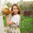 Girl holding a chicken — Stock Photo