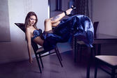 Girl fashion model sitting on chair — Stock Photo