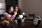 Girl guy pours tea — Stock Photo
