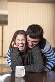 Man tickles the laughing woman — Stock Photo