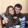 Loving man with a woman hugging — Stock Photo