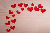 Red hearts on a wooden table — Stock Photo
