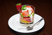 The menu - photo - appetizing dessert from fruits with cream — Stock Photo