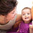 Mother and dauhter are laughing while playing with bear — Stock Photo #47926543