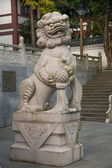 Shenzhen City, Guangdong Province, East Dameisha Huaxing Temple Main Hall lions — Stock Photo