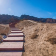 Zhangye Danxia Geopark uphill road and bridge — ストック写真