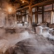 Foto Stock: Zigong one thousand meters ancient salt - Sun Sewells ruins reproduce ancient tradition of salt craft workshops