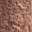 Stock Photo: Fushun Fushun County, SichuProvince, on door of Great Hall Temple exquisite sculptures