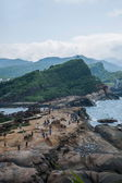 """Wanli District, New Taipei City, Taiwan """"Yehliu Geopark"""" one-sided hill overlooking the panoramic landscape rocks group Yehliu Geopark — Stock Photo"""