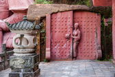 """Enshi toast toast Imperial City """"Nine into Hall"""" carved on the rock Tujia people statues — Stock Photo"""