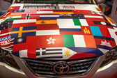 Flags of all nations Chongqing Auto Show Toyota on the hood — Stock Photo
