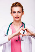 Doctor showing heart sign — Stock Photo