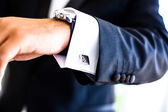 Hand with watch and cufflinks — Stock Photo