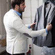 Handsome man shopping for clothes at a store. — Stock Photo #39758137