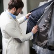Handsome man shopping for clothes at a store. — Stock Photo #39758143