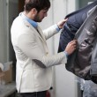 Handsome man shopping for clothes at a store. — Stock Photo #39758161