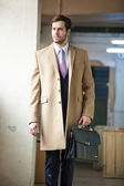Serious and elegant business man walking away — Stock Photo