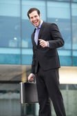 Successful businessman smiling — Stock Photo