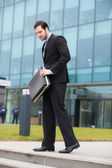 Businessman holding his briefcase — Stock Photo
