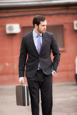 Serious businessman walking on the street — Stock Photo