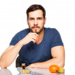 Man having in front pills and fruits, Choosing between them — Stock Photo #44814647
