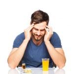 Man having in front pills and orange juice — Stock Photo #44814887