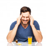Man having in front pills and orange juice — Stock Photo #44814895