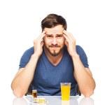 Man having in front pills and orange juice — Stock Photo #44814911