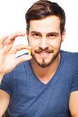 Handsome man showing pills  — Stock fotografie