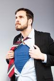 Jonge zakenman gedraagt zich als een super held — Stockfoto