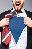 Young businessman acting like a super hero — Stock Photo