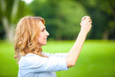 Nice woman taking pictures with smartphone — Fotografia Stock
