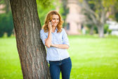 Beautiful young woman using her cellphone — Stock Photo