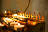 Candles on the table in orthodox church — Stock Photo