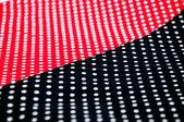 Tisuue rouge et noir à pois blancs — Photo