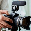 Stock Photo: Video cameroperator working with his professional equipment