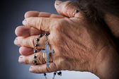 Praying with a rosary — Stock Photo