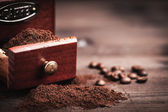 Coffee grinder and powder — Stock Photo