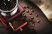 Coffee grinder and beans — Stock Photo