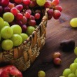 Wicker basket with autumn fruits - Stock Photo