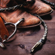 Cowboy boots,whip and spurs on wood — Stock Photo