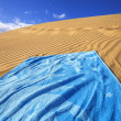 Sand dunes and towel — Stock Photo