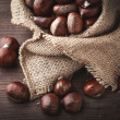 Stock Photo: Chestnuts in jute
