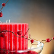 Red wax candle and barry — Stock Photo