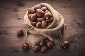 Chestnuts in jute — Stockfoto