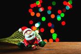 Santa Claus, lights and bokeh — Stock Photo