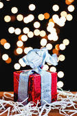 Gift box and silver ribbon — Stock Photo